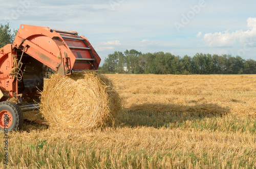 Special machines for harvesting form round bales of hay.