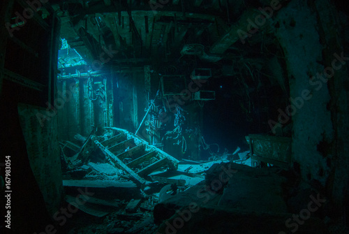 Foto op Aluminium Schipbreuk a natural light shot of the inside of the shipwreck of the captain keith tibbetts in little cayman. The inside of this room is a spooky image as the sun lights up a small section