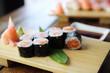 Salmon maki sushi on wood background , Japanese food