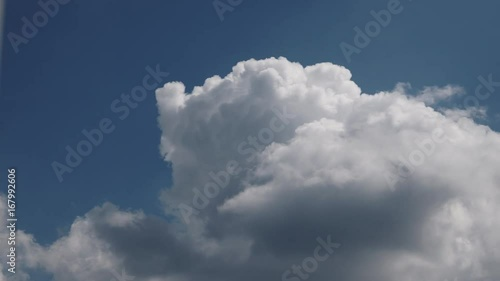 Skyscape or cloudscape. Blue sky with white clouds moving across it. Weather. Time lapse. 4K ProRes HQ codec