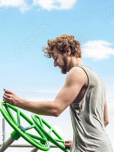 Active man exercising with tai chi wheel.