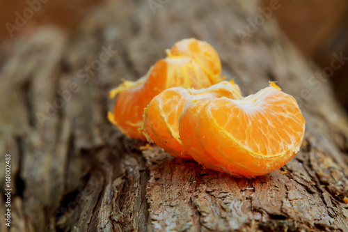 Still life with orange on wood background - 168002483