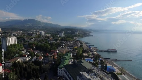 Wall mural Seafront of Alushta in Crimea from drone in spring with piers cuts Black sea