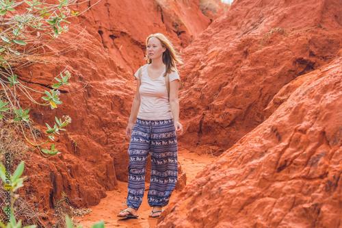 Foto op Canvas Baksteen Young woman in red canyon near Mui Ne, southern Vietnam