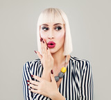 Fashion Portrait of Surprised Woman in Striped Cloth. Beautiful Girl Fashion Model with Makeup, Bob Hairstyle and Manicure on Background with Copy Space