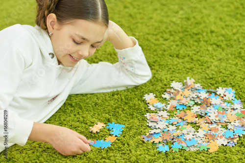 girl collecting puzzle pieces Poster