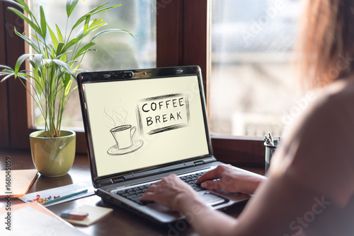 Wall mural Coffee break concept on a laptop screen