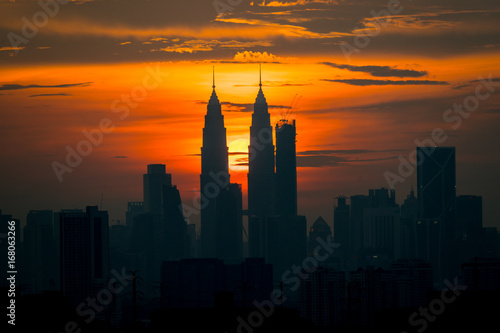 A cloudy sunset in Kuala Lumpur, the capital of Malaysia. Its modern skyline is dominated by the 451m tall KLCC, a pair of glass and steel clad skyscrapers.