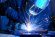 Leinwanddruck Bild - Welder erecting technical steel