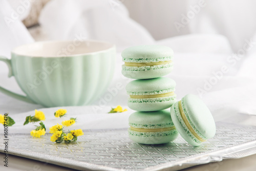 Turquoise mint macarons. French delicate dessert for Breakfast