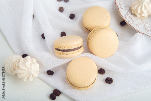 Wall mural Coffee macarons with chocolate. French delicate dessert for Breakfast