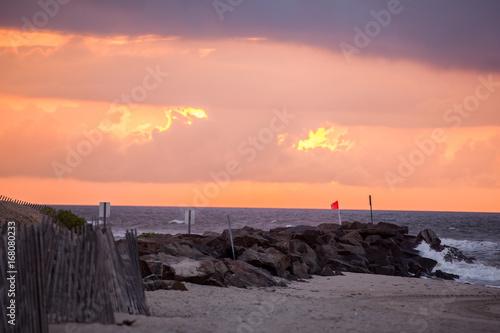 Foto op Canvas Lavendel Sunrise Waves on Rocks
