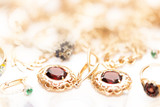 gold jewelry with garnets, emeralds