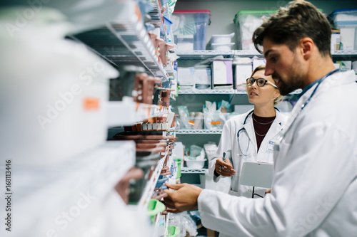Papiers peints Pharmacie Pharmacists checking inventory at hospital pharmacy