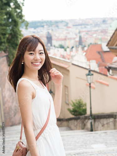 portrait of young asian woman traveling in europe