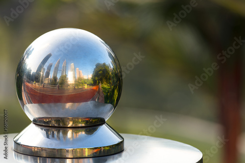 KL twin towers reflecting in a metal sphere. Poster