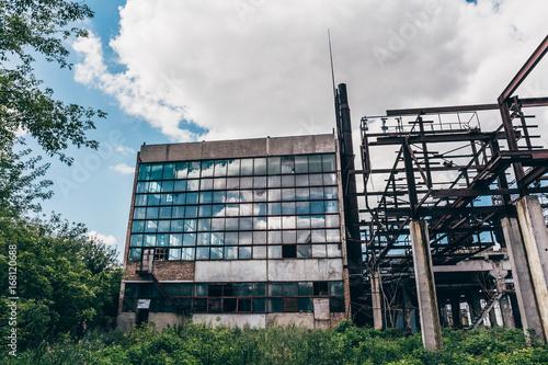 Foto op Plexiglas Oude verlaten gebouwen Facade exterior of large Soviet abandoned factory