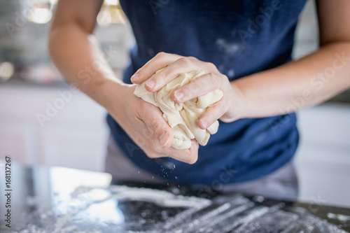 Making dough with flour by female hands, close up