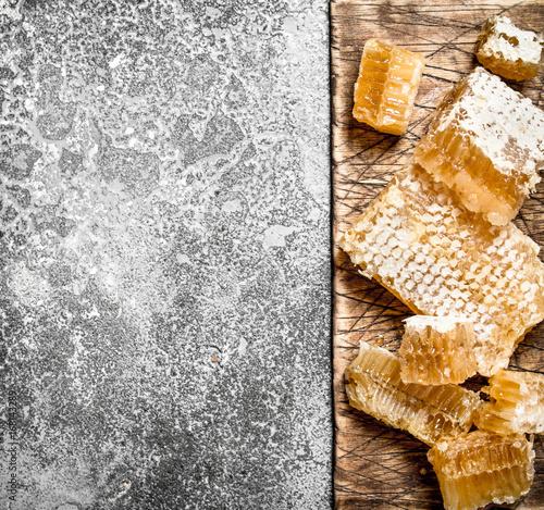 Honey background. Fresh honeycomb on the Board.