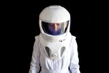 Astronaut in a helmet looks down. Fantastic space suit. Exploration of outer space. - 168163643