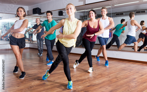 Adults having group fitness class - 168165487