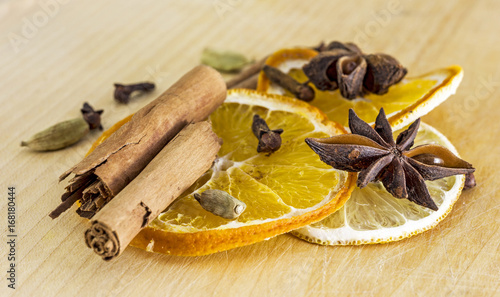 Sliced orange, cinnamon stick, clove, cardamon, star anise - 168180444