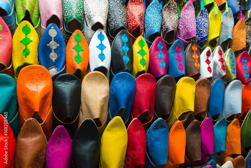 Foto op Canvas Marokko assorted shoes at market stall in morocco