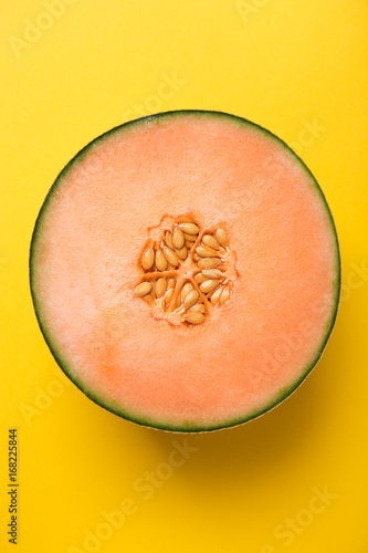 Tasty fresh yellow appetizing cut melon pastel background - 168225844
