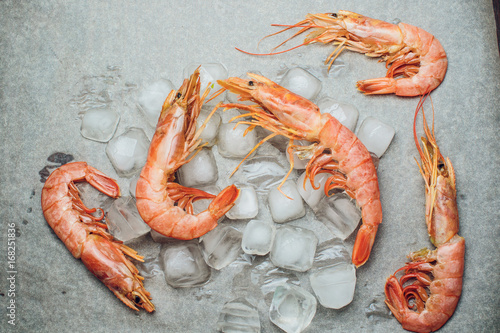 Fototapeta Red shrimp on a wooden board ice papper Argentina