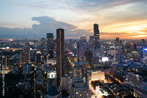 Wall mural Modern building in Bangkok business district at Bangkok city with skyline at twilight, Thailand.