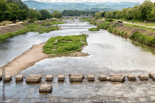 Fotobehang Kyoto The Kamo River in \kyoto, Japan in the Summer
