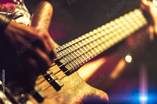 Bassist pop rock during a performance at a concert - 168280261