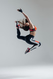 Young beautiful fitness female posing in studio - 168281670