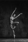 Young beautiful dancer is posing in studio - 168284244