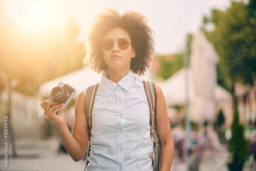 Mixed race tourist making a tour through the city