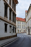 Czech Republic, Prague. Street between old tenements houses with red tiles.