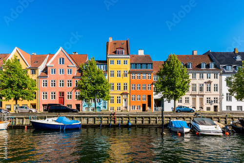 Colourful houses along canal in Downtown District of Copenhagen Denmark