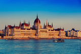 Budapest Parliament building and Danube river at sunset, travel Hungary background
