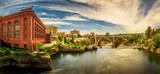 Fototapety Washington Water Power building and the Monroe Street Bridge along the Spokane river