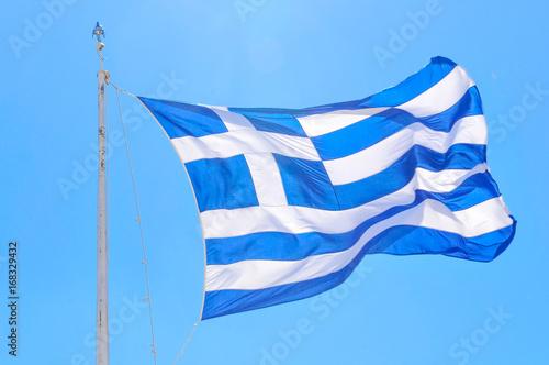 Papiers peints Athenes Greek flag against blue sky