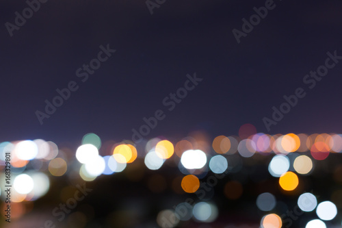 city night with dark sky, abstract blur bokeh light background - 168329801