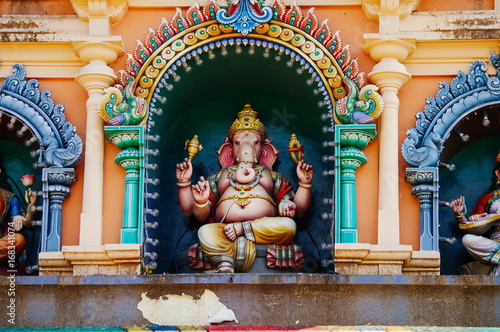 Ganesha Statue a Hindu deitiy on the roof of temple within Batu Caves Poster