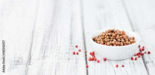 Portion of Pink Peppercorns (preserved) , selective focus