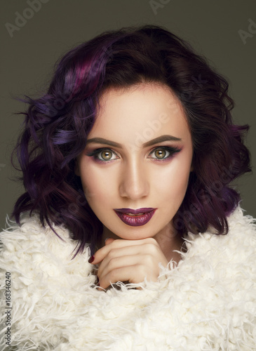 Portrait of beautiful sexy fashion model with purple hair over grey background