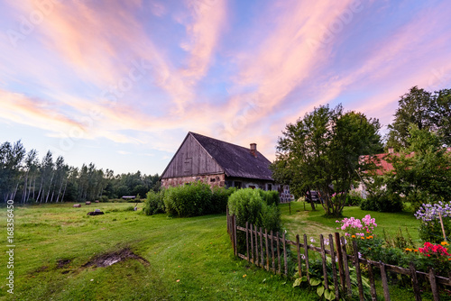 Fotobehang Purper dramatic sunset over countryside