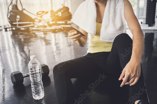 Sticker asian sportswoman with white towel using smartphone