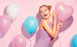 Beauty joyful teenage girl with colorful air balloons having fun over pink background - 168382408