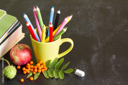 Back to school abstract background with crayons on blackboard