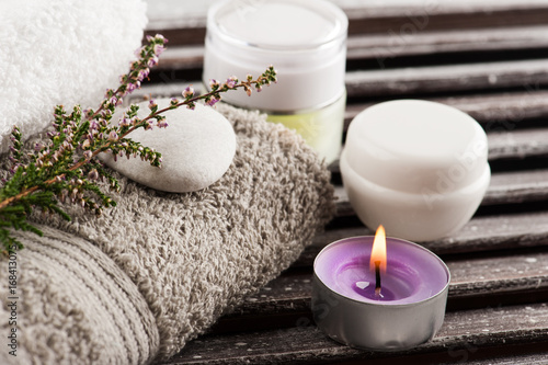 SPA composition with cosmetic products, towels, heather flowers