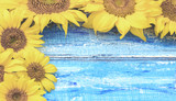 Autumn background with sunflowers on wooden board. Yellow fresh sunflowers on rustic wooden table background